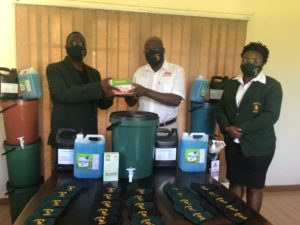 Harare Province Chairperson Joseph Kawonza receiving the PPE's